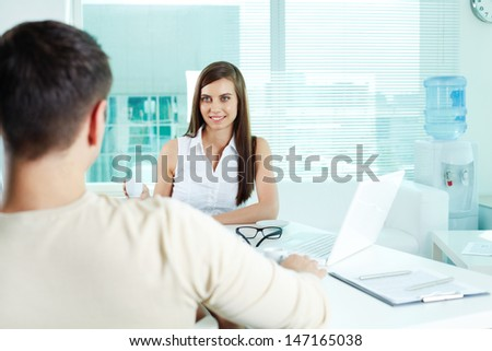 Photo of cute secretary looking at her boss in office - stock photo