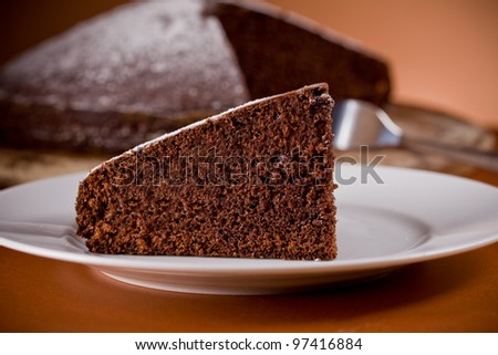 photo of delicious chocolate cake on wooden table - stock photo