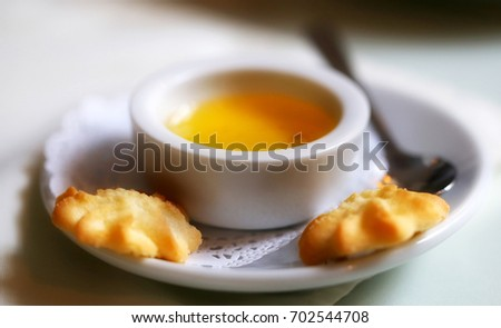 Photo of delicious honey and biscuits on a light background