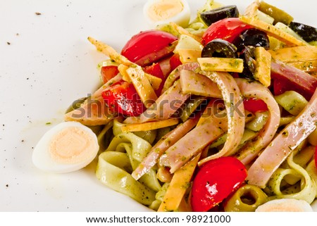 photo of delicious pasta (tagliatele) with bacon and tomatoes - stock photo