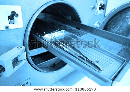 photo of dental tools in sterilizer, blue tone - stock photo