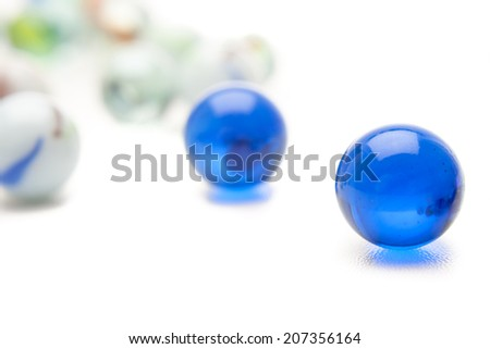 photo of different color marbles on white - stock photo