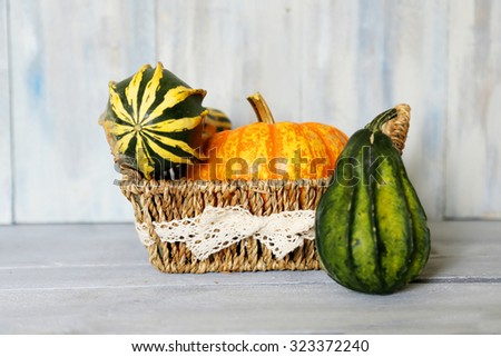 Photo of 3 different pumpkin in a basket - stock photo