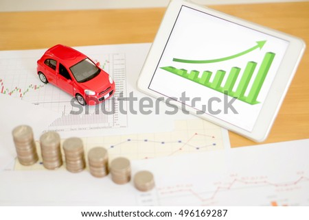 Photo of document some graphics with calculator and car and money