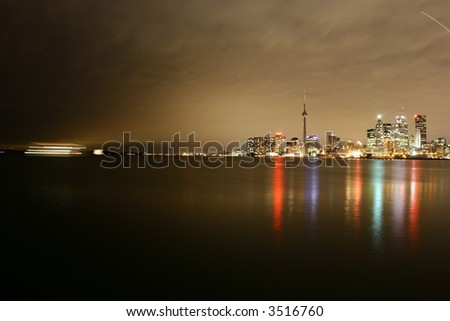 photo of downtown in Toronto, canada (night lake vew) - stock photo