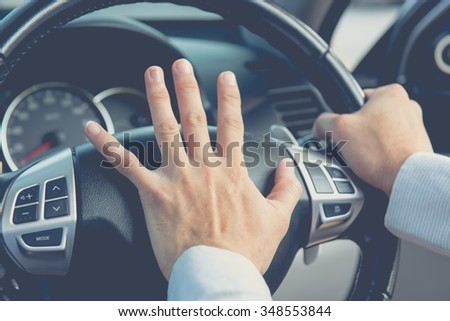 Photo of driver honking in traffic on the road - stock photo