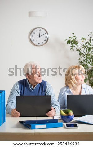 Photo of elderly busy marriage working together - stock photo