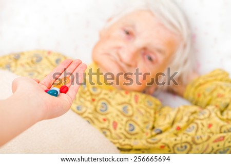 Photo of elderly woman taking the medication - stock photo