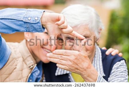 Photo of elderly woman with grandchild having funny - stock photo