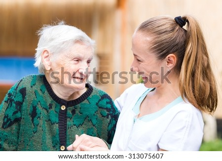 Photo of elderly woman with her caregiver