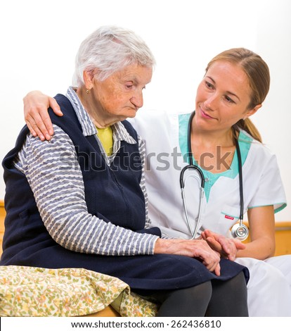 Photo of elderly woman with the young doctor - stock photo