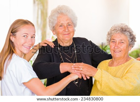 Photo of elderly women with their carer  - stock photo