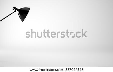 Photo of empty studio room with black lamp, nobody. 3d render - stock photo