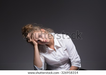 Photo of exhausted woman having a crisis at work - stock photo