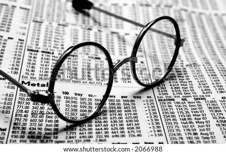 Photo of Eyeglasses on Top of Futures Pricing and Quotes - Investing Concept