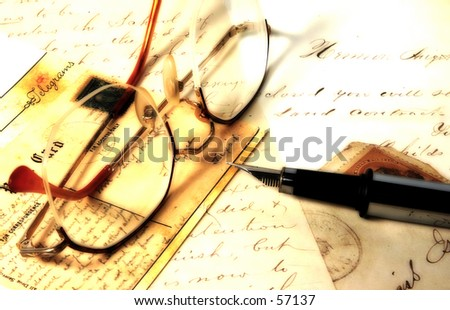 Photo of Eyeglasses, Pen and Letters With Color and Blur Effect