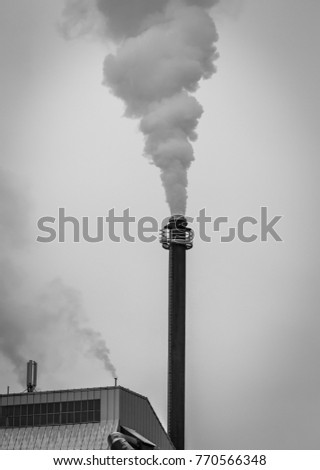 Photo of factory chimney.