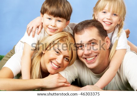 Photo of family members smiling at camera - stock photo