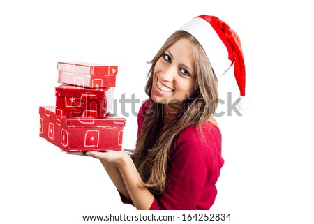 Photo of fashion Christmas smiling girl with gifts