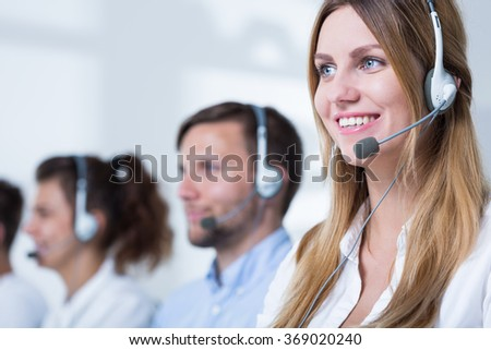 Photo of female consultant with headset in call center - stock photo