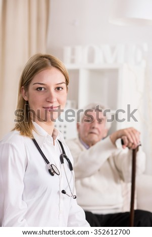 Photo of female doctor during private home visit