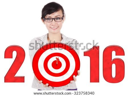 Photo of female entrepreneur holding bullseye with numbers 2016. Isolated on white background - stock photo
