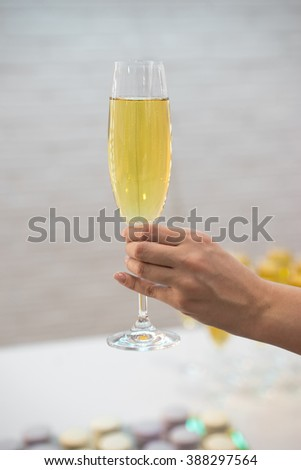 Photo of female hand holding flute of champagne - stock photo