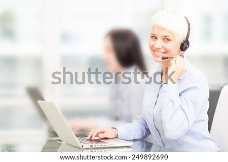 photo of female support assistant working on the computer in the office - stock photo