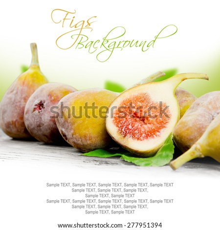 Photo of figs with slice and leaves on burlap and wooden board - stock photo