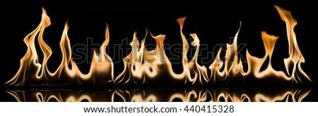Photo of fire wall  on a black - stock photo