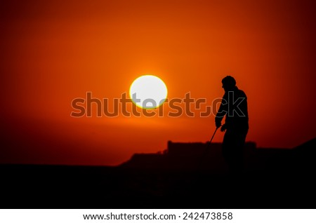 Photo of Fisherman Silhouette with Fishing Rod on Sunset Background - stock photo