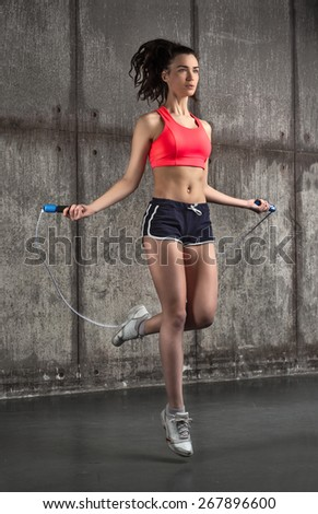 photo of fit adult girl in air - stock photo