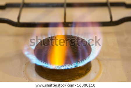 Photo of flames of kitchen oven burning gas - stock photo