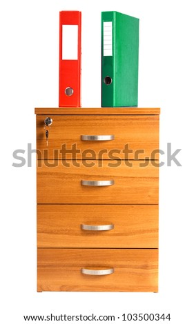 Photo of folders standing on wooden cabinet with key - stock photo