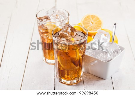 Photo of fresh lemon ice tea on white wooden table - stock photo