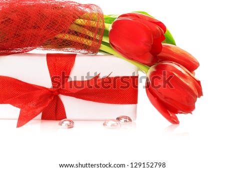 Photo of fresh red tulips flower isolated on white background, white gift box with beautiful ribbon bow, shiny beads, festive still life, romantic holiday, happy mothers day, present for birthday - stock photo