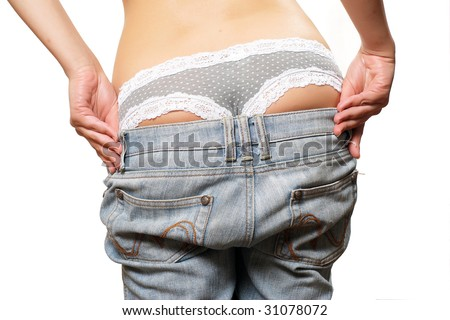 Photo of girl back in jeans and colored panties. Undressing - stock photo