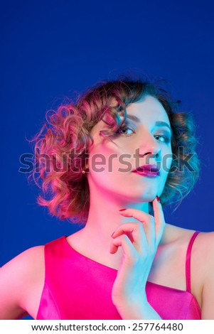 Photo of girl in studio with mixed light - stock photo