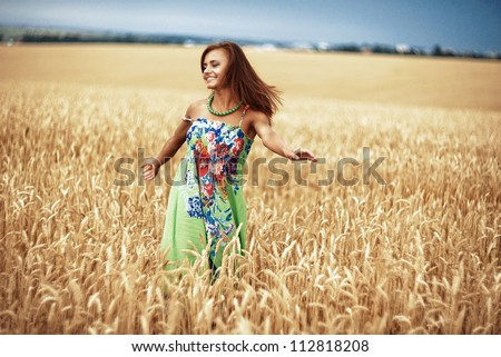 Photo of glad girl enjoying life in wheat meadow - stock photo