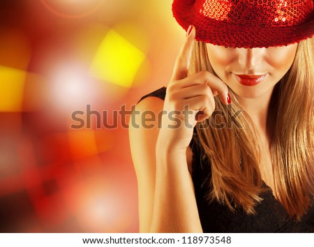 Photo of gorgeous dancer female with finger up on the stage in disco club, closeup portrait of pretty blond woman isolated on shining background, night lifestyle, Christmas party, New Year eve - stock photo