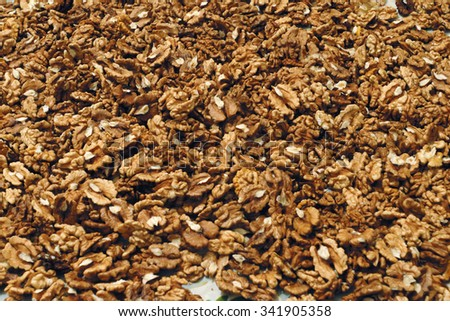 Photo of Greek nut background. Nuts have brown color.