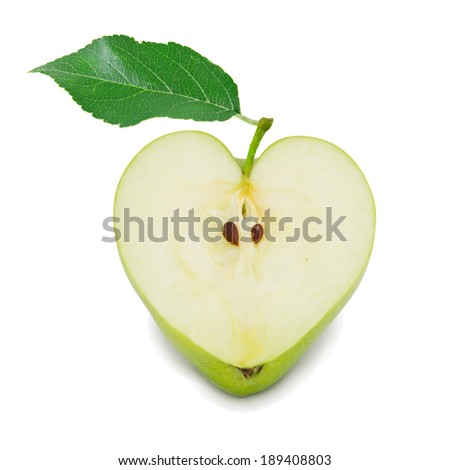 Photo of green apple slice with leaf in a heart shape