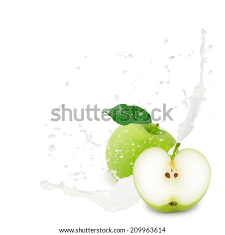 Photo of green apple with leaf and milk splash isolated on white