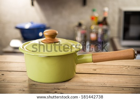 photo of green pot in kitchen - stock photo