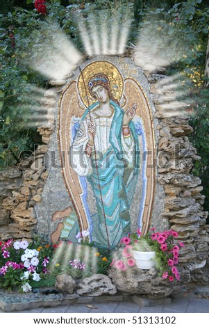 Photo of Guardian Angel mosaic in garden of Russian Orthodox monastery as faith concept . - stock photo