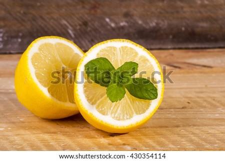 photo of half a lemon with fresh mint - stock photo