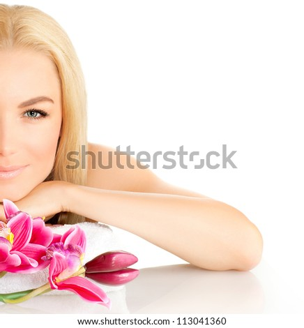 Photo of half woman face, beautiful young lady in spa, cute female enjoying aromatic massage, good looking girl with pink orchid flowers isolated on white background, spa relaxation concept