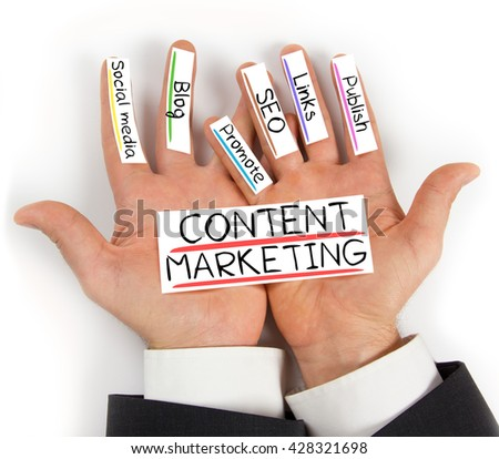 Photo of hands holding paper cards with CONTENT MARKETING concept words - stock photo