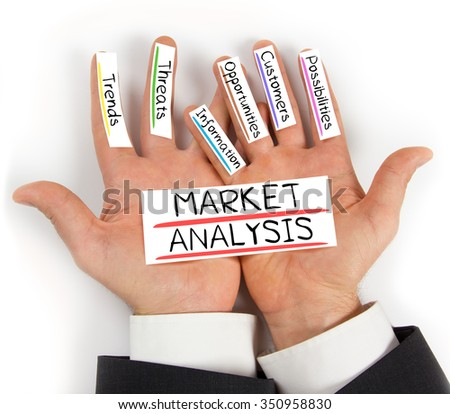 Photo of hands holding paper cards with MARKET ANALYSIS concept words - stock photo