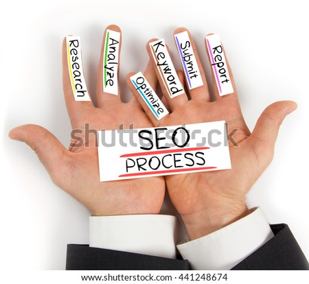 Photo of hands holding paper cards with SEO PROCESS concept words - stock photo